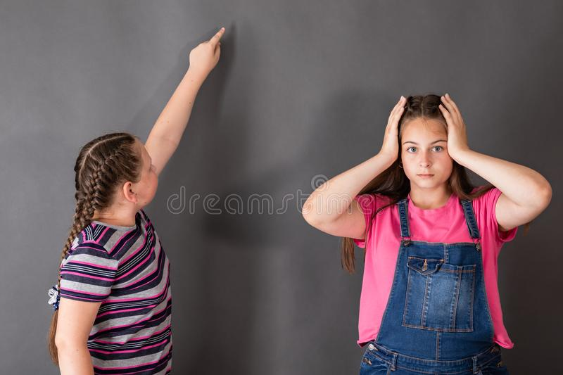 One girl is amazed at how easy and beautiful the other solves th royalty free stock photos