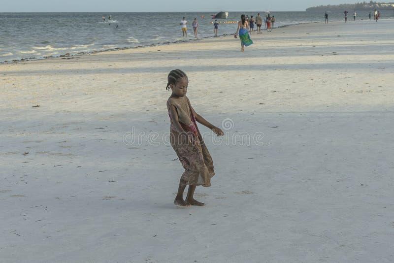 One girl on Zanzibar beach royalty free stock photo