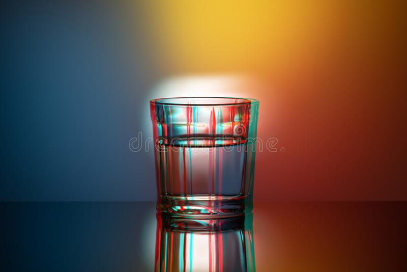 One glass Cup on a colored background, anaglyph, glitch effect, pop art. One glass Cup on colored background, anaglyph, glitch effect, pop art royalty free stock photos