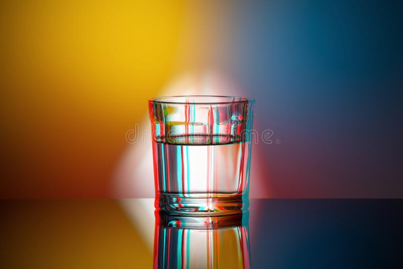 One glass Cup on a colored background, anaglyph, glitch effect, pop art. One glass Cup on colored background, anaglyph, glitch effect, pop art royalty free stock images
