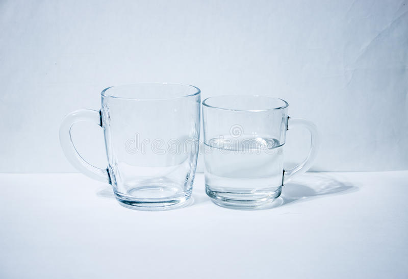 One glass empty second with water. Light background royalty free stock photos