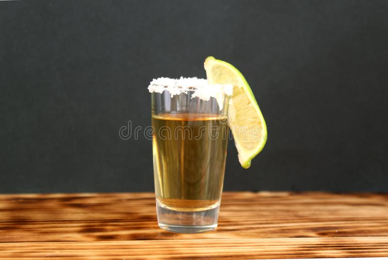 One glass of tequila with lime and salt stock images