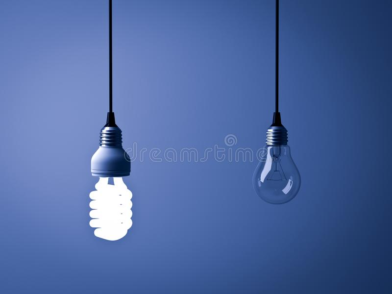 One glowing compact fluorescent lightbulb and unlit incandescent bulb on dark blue background. Eco energy saving light bulb , one glowing compact fluorescent royalty free stock photography