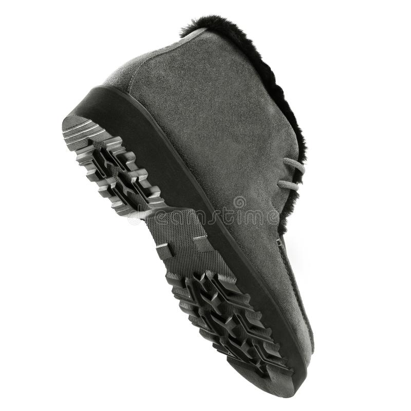One gray suede boot levitates, on a white background, as if steps, concept royalty free stock photo