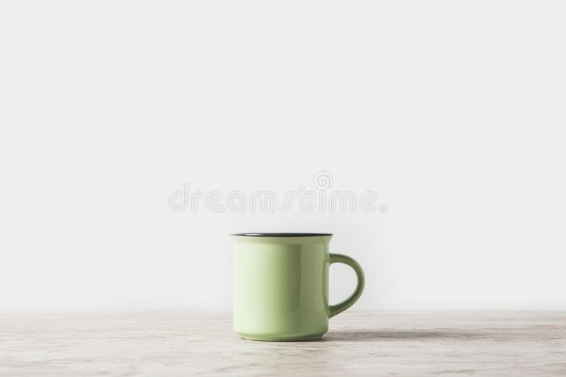 one green cup on marble table on white royalty free stock photos