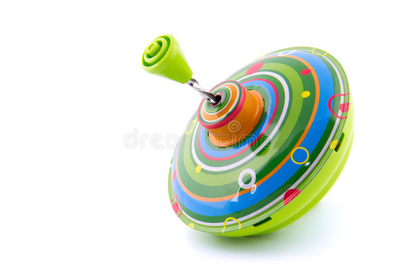 One green whirl toy. On white royalty free stock photos