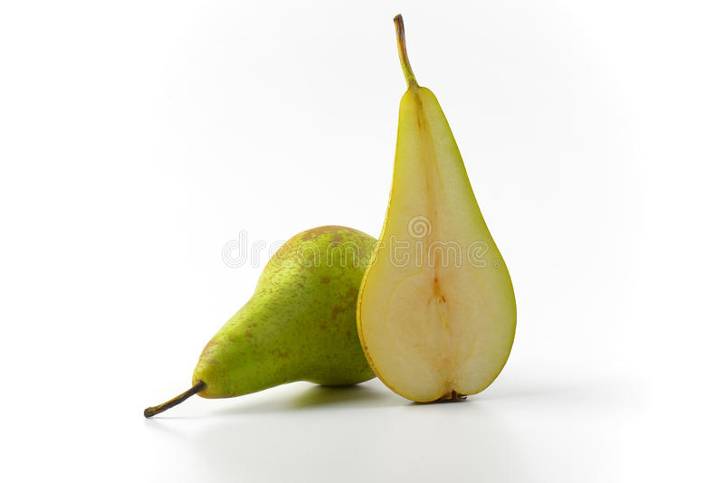 One and a half pears. One whole pear and a half cross section stock photography