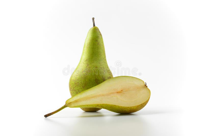 One and a half pears. One whole pear and a half cross section royalty free stock photography