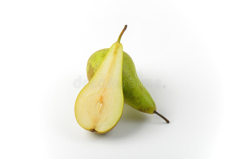 One and a half pears. One whole pear and a half cross section stock photos