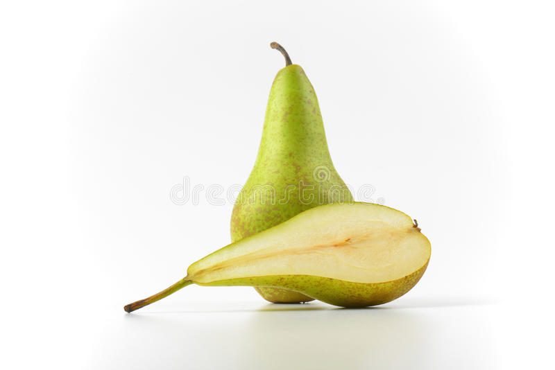 One and a half pears. One whole pear and a half cross section royalty free stock image