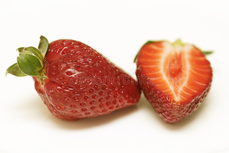 Download One And A Half Strawberries Stock Photo - Image of leaves, green: 112714