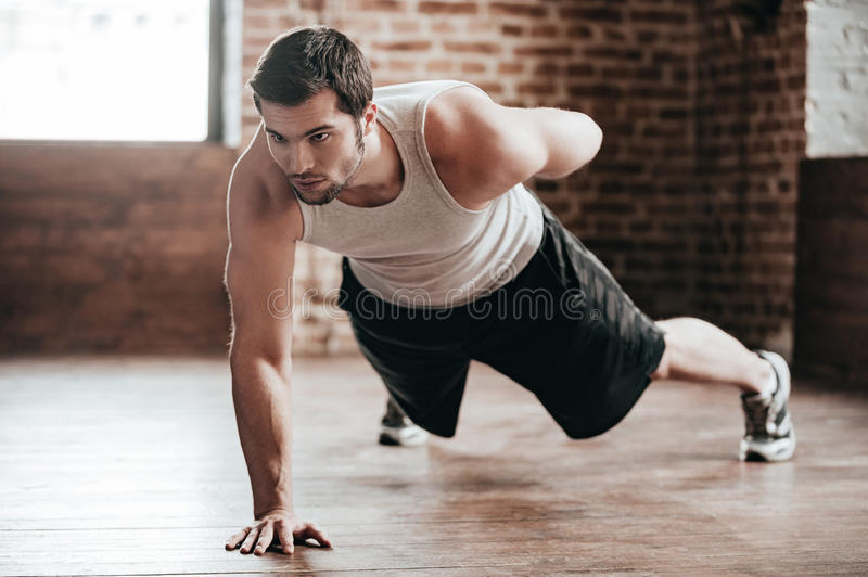 One hand push-up. stock images