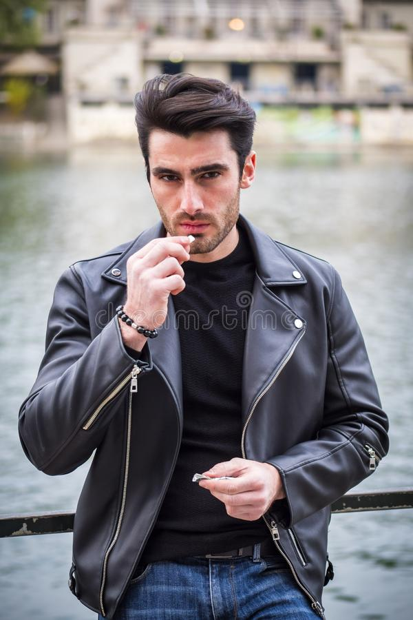 One handsome young man in modern city setting stock image