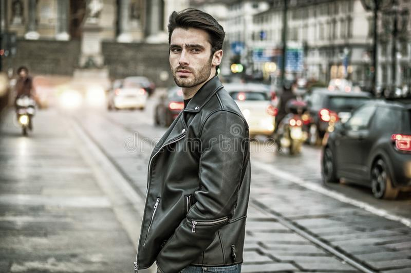 One handsome young man in modern city setting stock photography