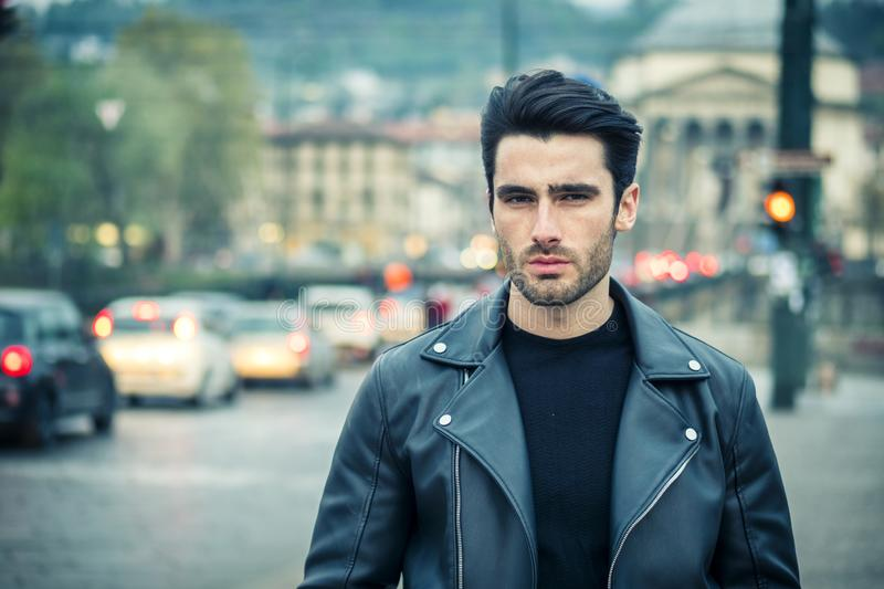 One handsome young man in modern city setting stock images