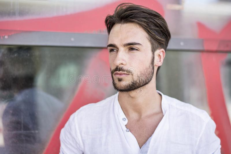 One handsome young man in city setting stock image