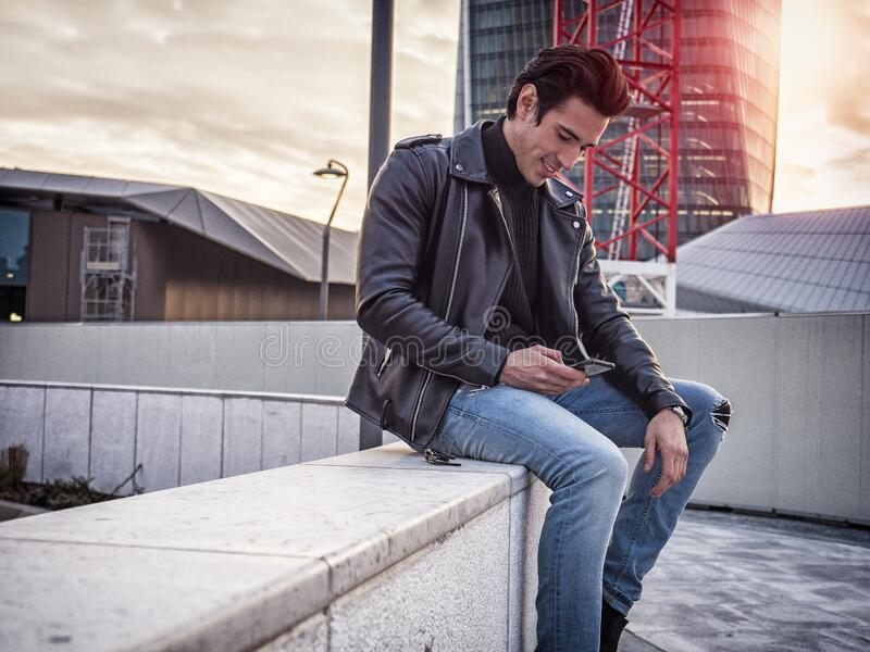 One handsome young man in modern city setting royalty free stock photo