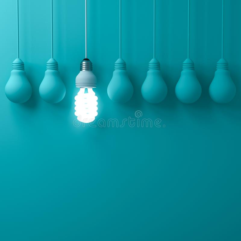 One hanging eco energy saving light bulb glowing and standing out from unlit incandescent bulbs on dark green pastel color royalty free illustration