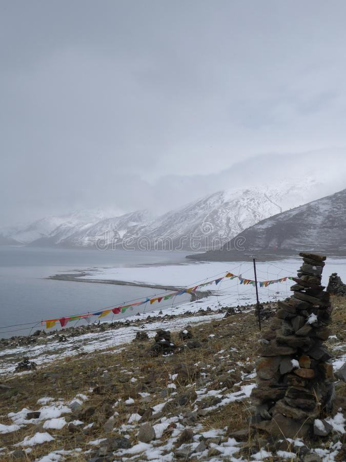 Yamdrok Lake Holy lake in Tibet. One of the holiest lakes in Tibet, Yamdrok lake on the way from Lhasa to Gyantse stock photo