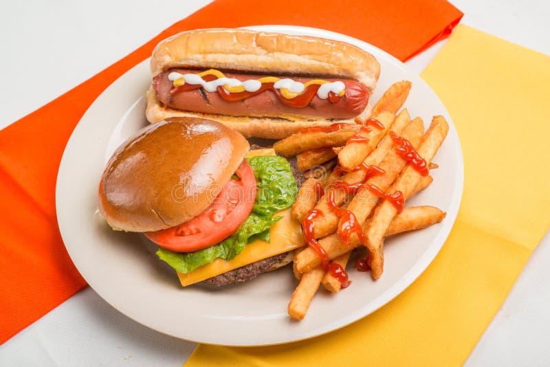 Hamburger and Hotdog with fries stock photo