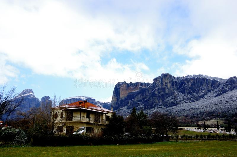 One house at the foot of the mountain in nature. There is one house at the foot of the mountain in Greece. That view is colorful, blue sky and mountain covered royalty free stock photography