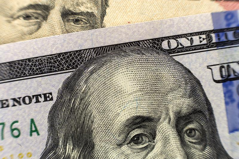 One hundred dollar bill detail with president Benjamin Franklin portrait close-up. American national currency banknote. Symbol of stock photos