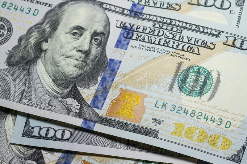 One hundred dollar bills close up with selective focus stock images