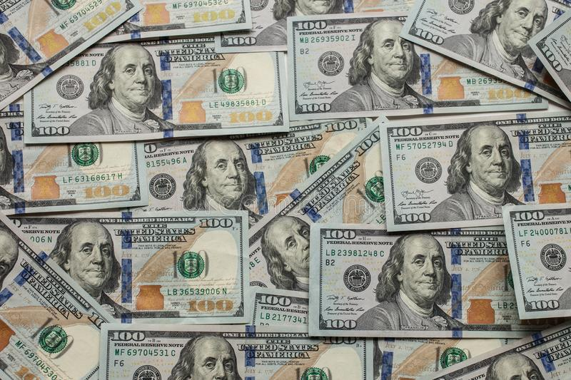 One hundred dollars banknotes background new 2013 edition. Concept of money, earnings, wealth and banking. one hundred dollars banknotes background new 2013 stock photos