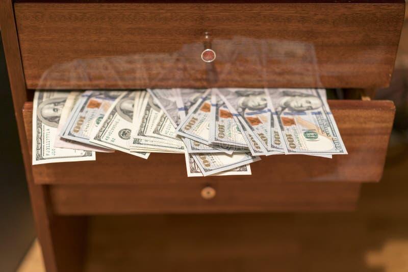One hundred dollars bills in desk drawer.  stock images