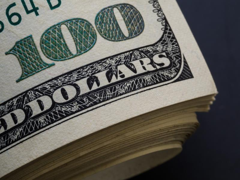 One hundred dollars corner of banknote with magnification stock photography