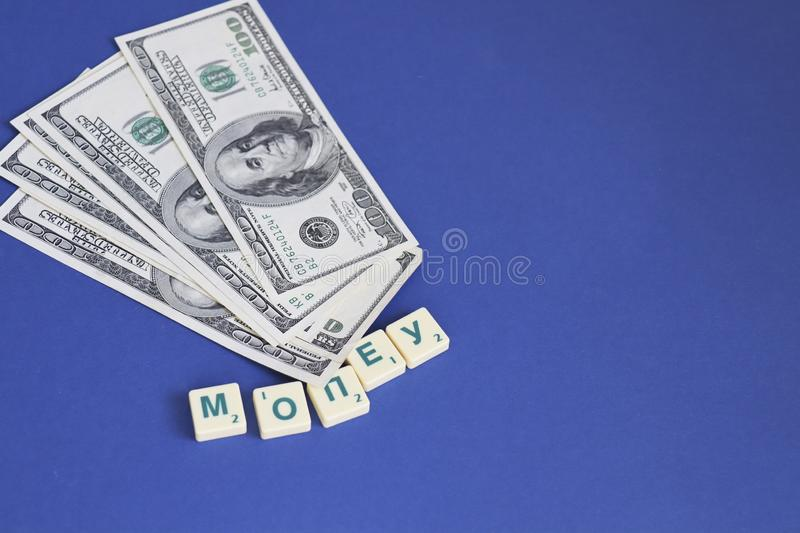One hundred dollars pile as background. Copy space stock images