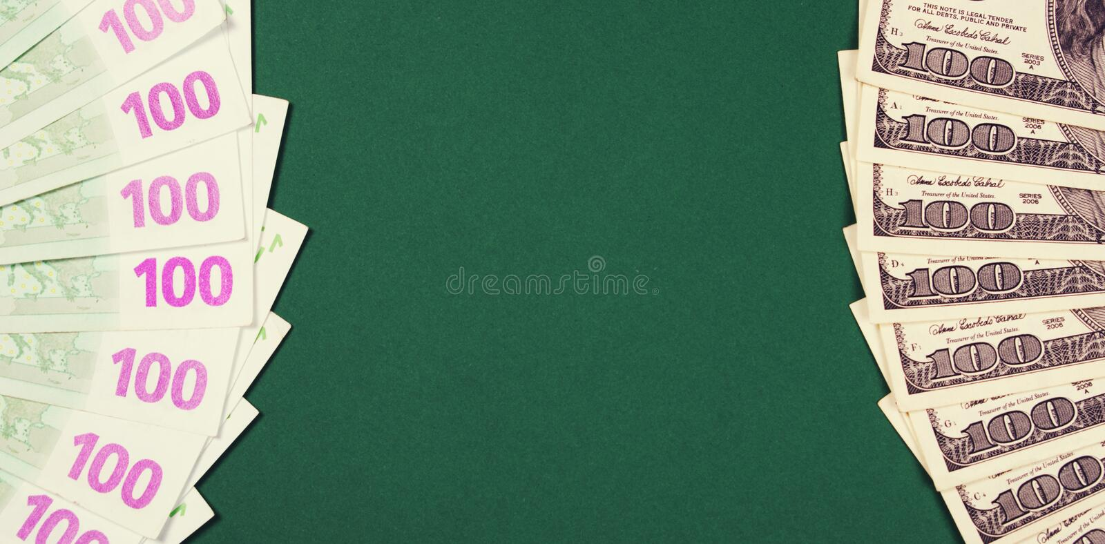 One hundred euro and dollar notes on green background. royalty free stock images