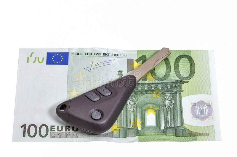 One hundred euros banknote and car keys isolated on white. Closeup with copy space stock images