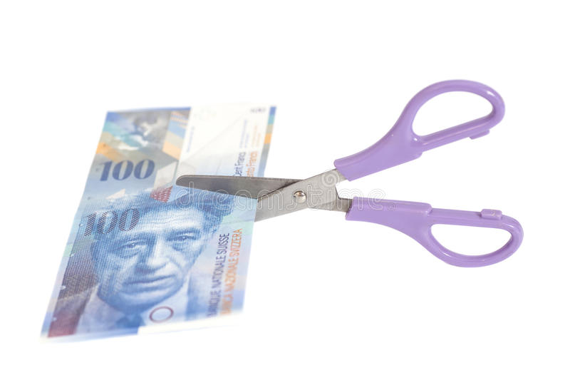 One hundred swiss franc banknotes with scissors.currency. Of switzerland isolated royalty free stock photos