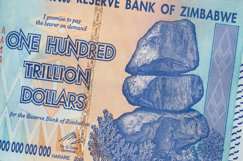 One hundred trillion dollars - Zimbabwe. Banknote of Zimbabwe of one hundred trillion dollars. This banknote has the highest nominal value in history. The hyper royalty free stock images