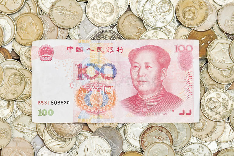 One hundred yuans on heap of old coins royalty free stock image