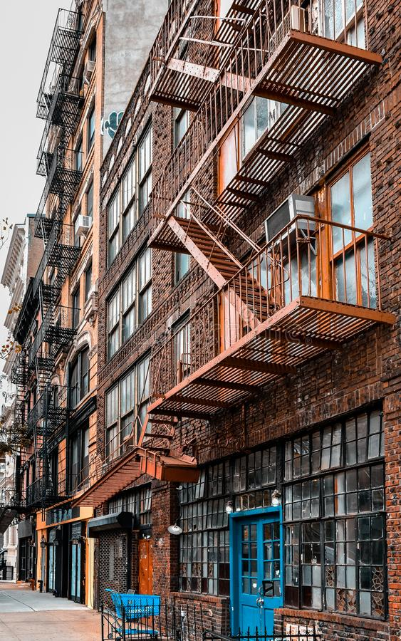 One Industrial old apartment facades, with fire stairs. Soho, Manhattan. NYC. USA royalty free stock photo