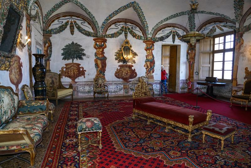 One of the interior rooms decorated with tapestries of the castle of Masino. The castel of Masino,Piedmont,italy Immersed within extensive grounds, this is the royalty free stock photo