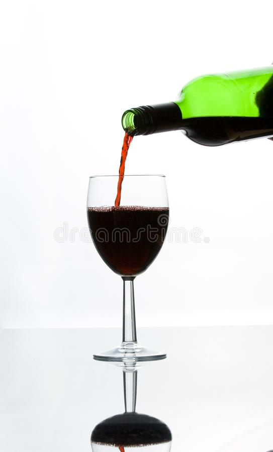 Red wine in a glass royalty free stock photo
