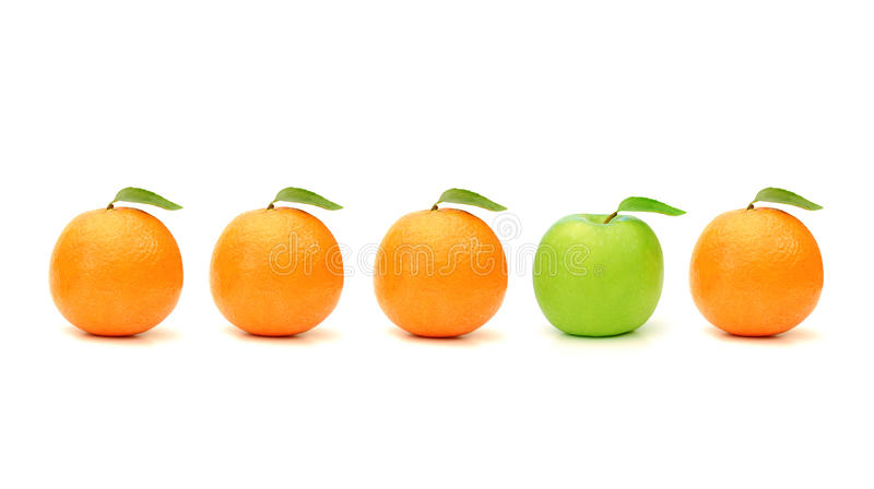 One of a kind. Green apple stands out in a line of oranges