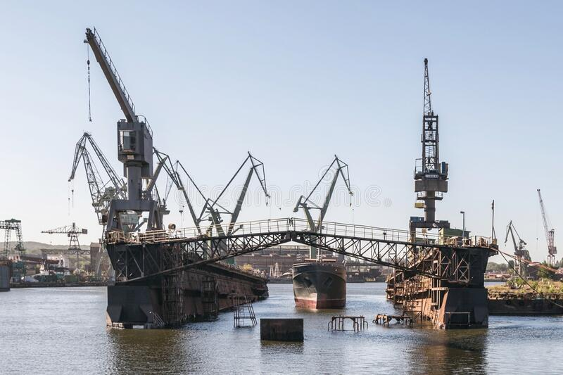 One of the largest Polish shipyards, located in Gdask on the left bank of the Martwa Wisa and Ostrow in Poland. Lech Walesa royalty free stock photography