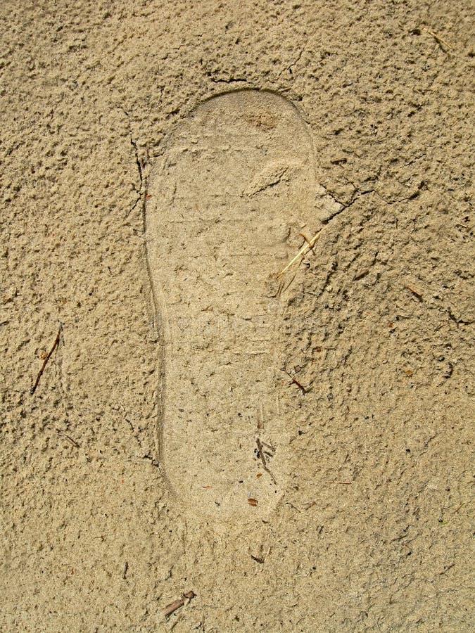 One left footprint on the grunge wet sand,