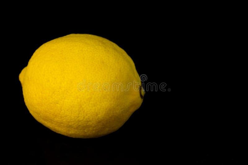 One lemon isolated on black background. stock photos