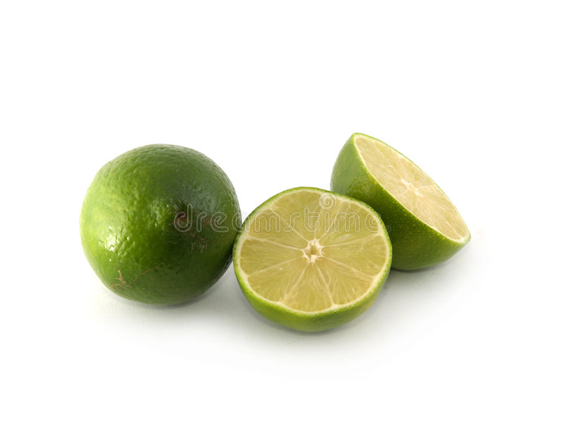 One lime and two halves stock photos