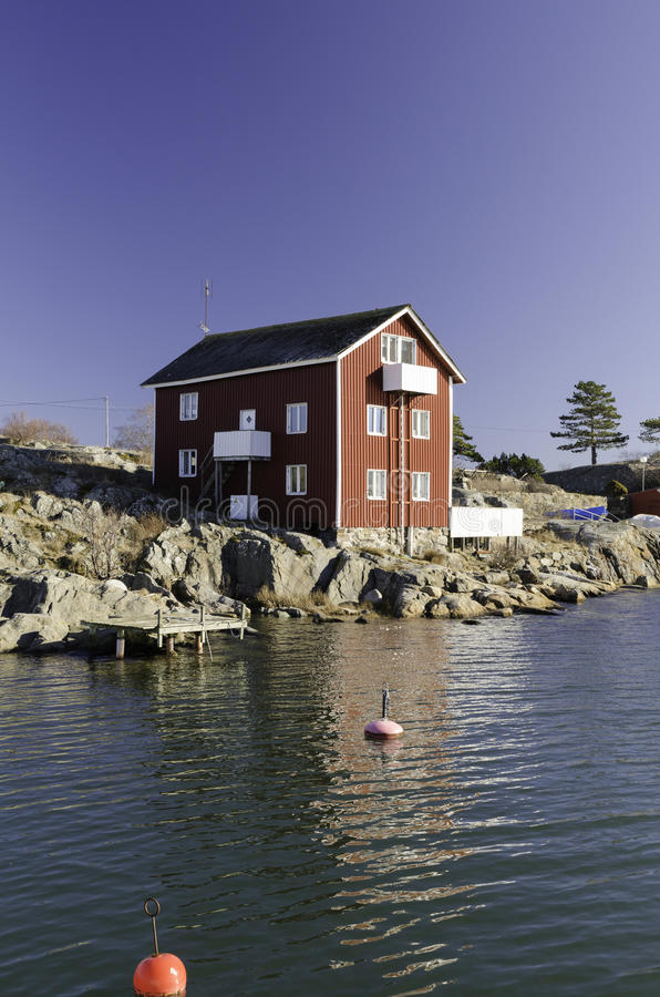 One little house on the swedish west coast stock photography