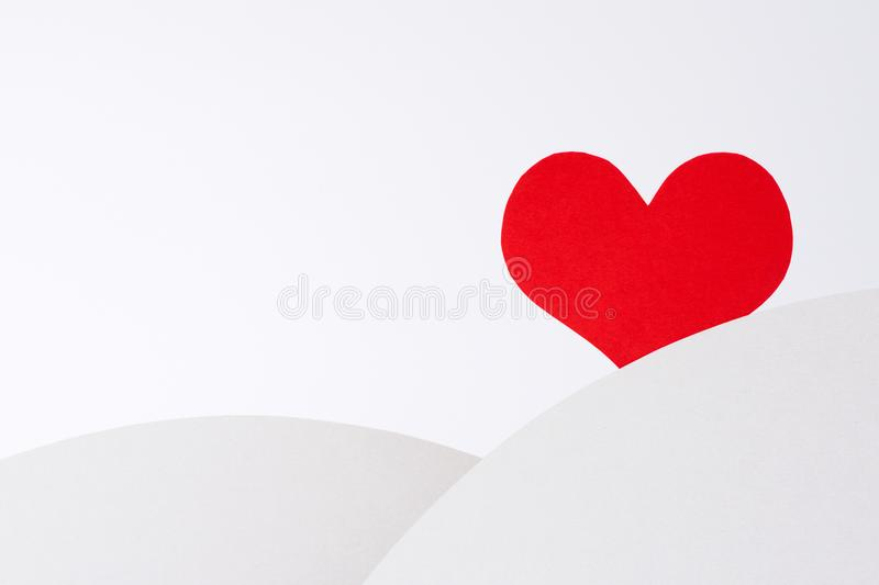 A lonely red heart is waiting for love. stock photo