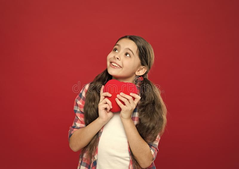 One love one heart. Little girl holding red heart. Having heart problem and heartache. Little child expressing love on. Valentines day. Cute girl in love. Happy royalty free stock image