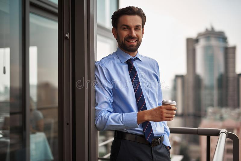 One male worker drinking coffee on office balcony royalty free stock photos