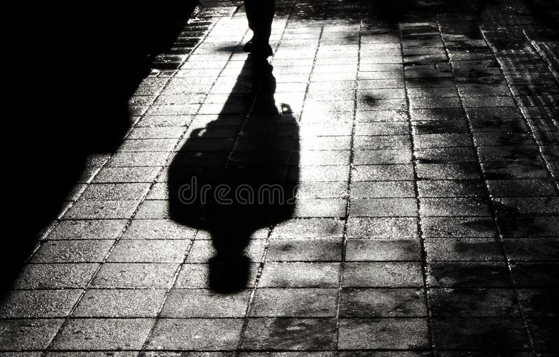 One man alone in the dark shadow silhouette royalty free stock image