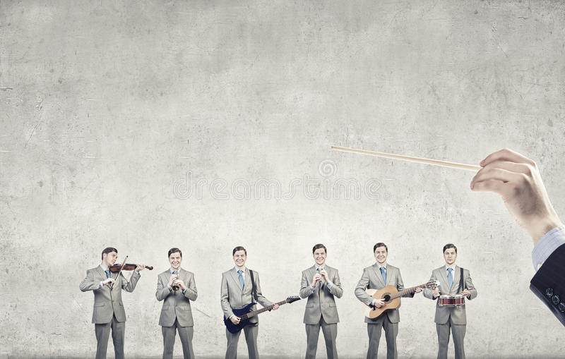 One man band. Man orchestra in suit playing different music instruments stock photos